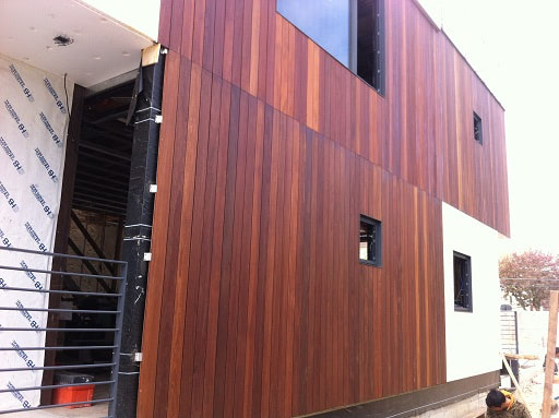 Cumaru hardwood rain screen on residence in Queens, NY