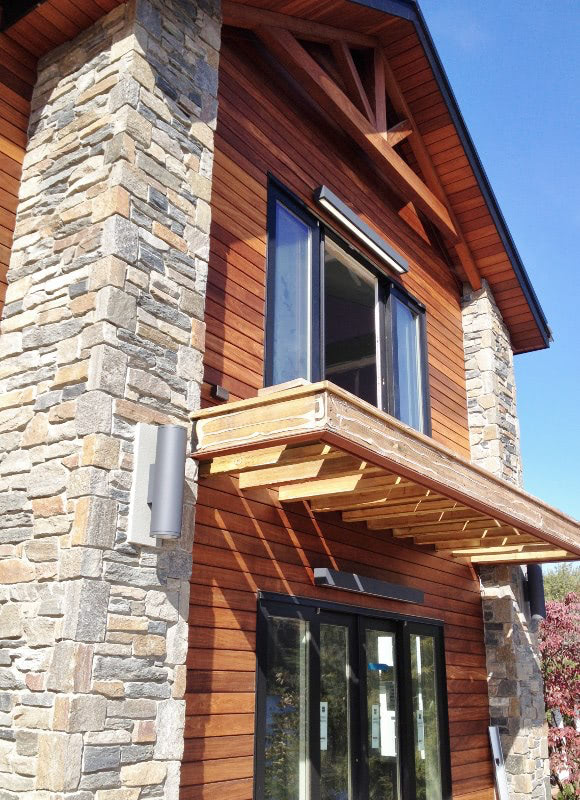 Ipe siding with stone