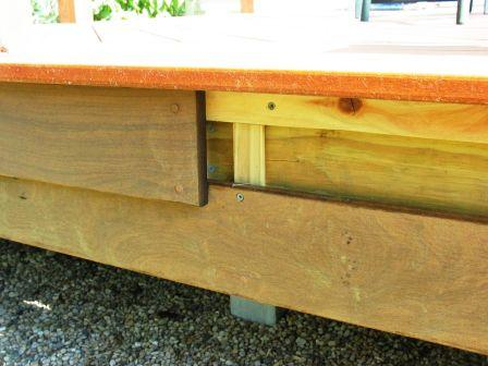 Ipe deck boards were selected for the fascia trim to cover the deck's rim joists