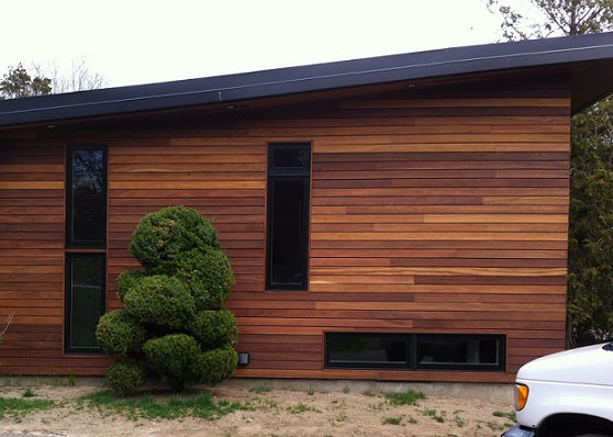 Red Cumaru hardwood rainscreen siding installation
