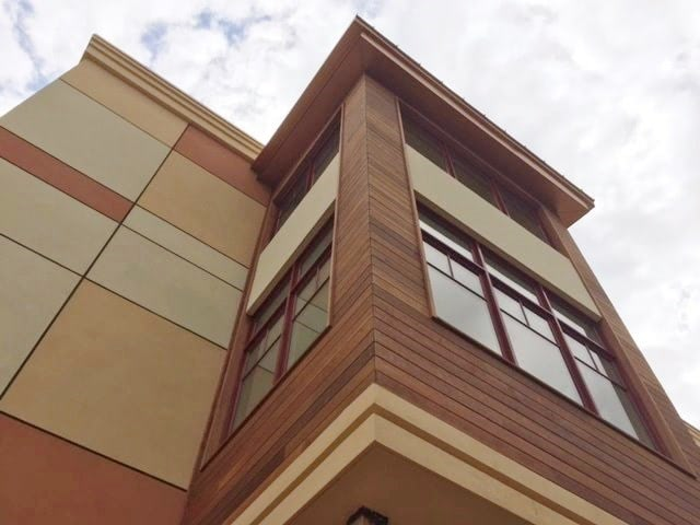 Hardwood rain screen combined with EIFS stucco finish
