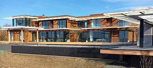 Garapa hardwood rain screen siding graces new home in the Hamptons