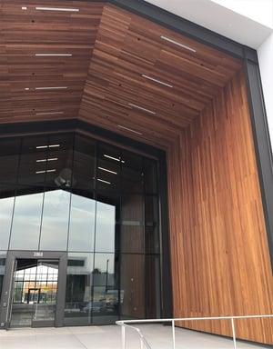 Garapa vertcial rainscreen and soffits at entrance