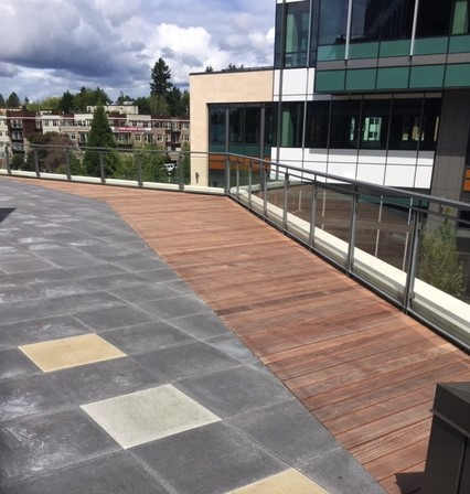 Integrated rooftop deck with full length hardwood boards and pavers