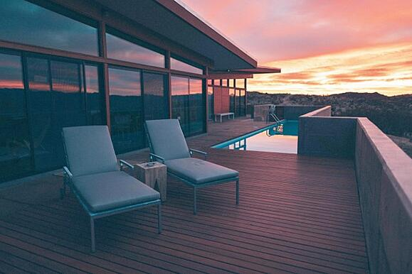 Ipe hardwood deck - photo courtesy of Roberto Nickson - lounge deck chairs next to infinity pool at sunset overlooking the landscape