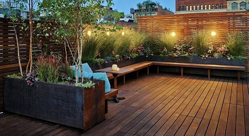 Ipe hardwood deck with built-in seating, planters and privacy screening