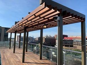 Ipe pergola provides shade on Boston rooftop deck