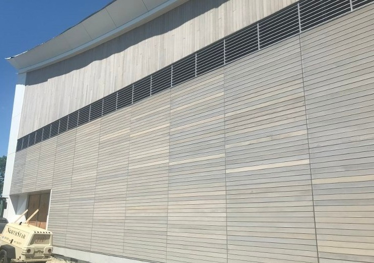Ipe vertical and horizontal siding under construction at Providence College