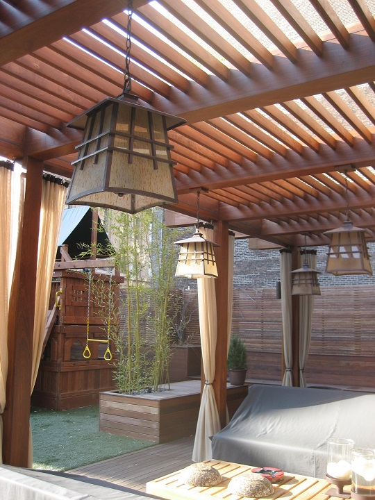 Ipe hardwood decking with pergola and arbor an oasis with curtains lanterns and cushions