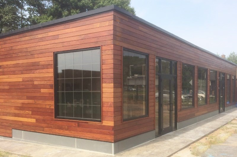 Machiche rainscreen siding adds warmth and beauty to retail facade
