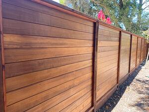 Thermally Modified Hemlock siding used as fencing with Penofin Oil finish