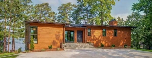 Trespa Pura Romantic Walnut cladding on lakefront home in Alabama