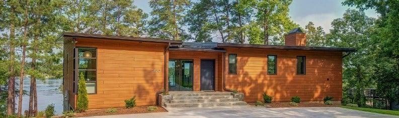 Trespa Pura Romantic Walnut cladding on residential home