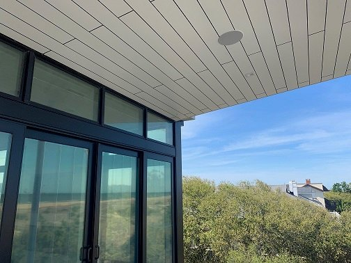 Trespa Pura siding Pure White P05.0.0 for soffits on outdoor deck on ocean side