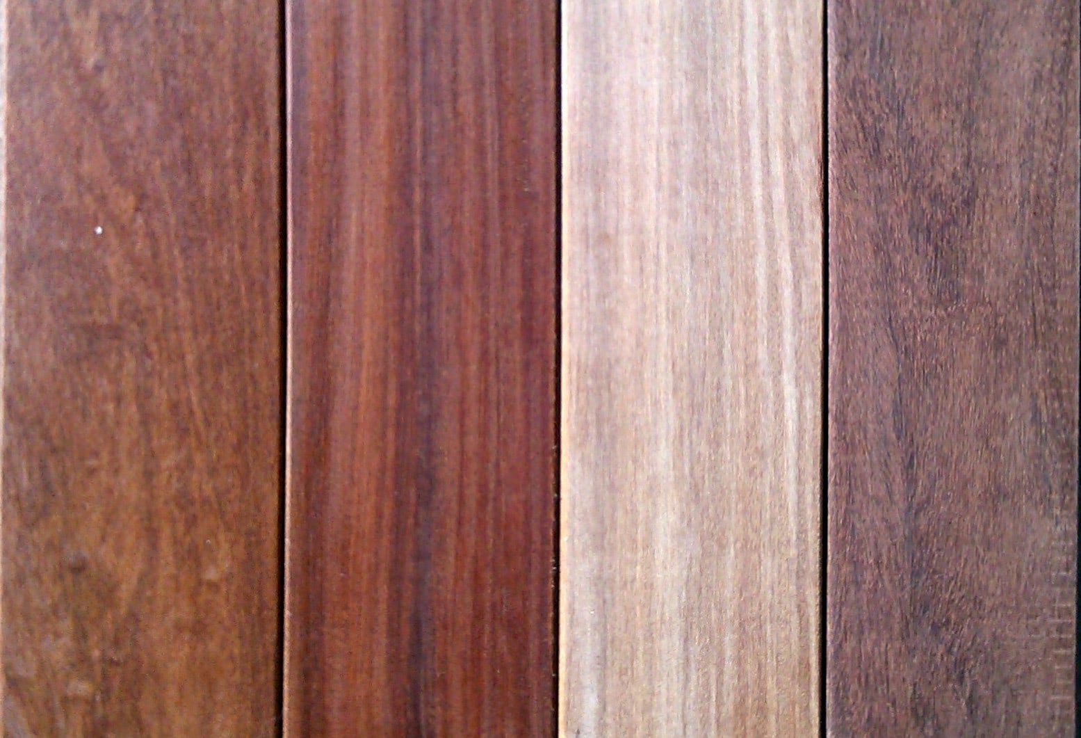 a range of cumaru decking tones finished and unfinished