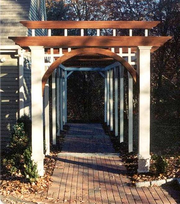 Ipe hardwood design feature pergola arbor over a brick walkway