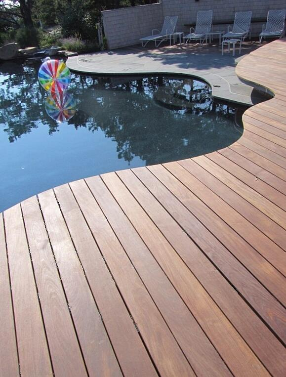 Ipe Hardwood Deck curved to follow in ground pool in Cape Cod