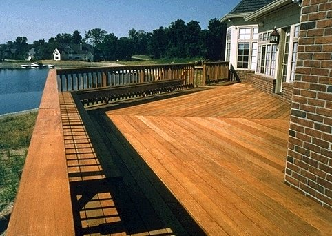 Ipe hardwood deck with built in benches and a harbor view