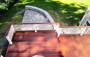 Ipe backyard deck with white rails and Ipe rail cap