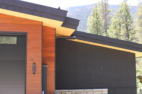 thermally modified hemlock siding and soffits all stained different shades