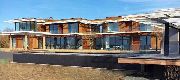 Garapa hardwood rain screen siding graces new home in the Hamptons-1