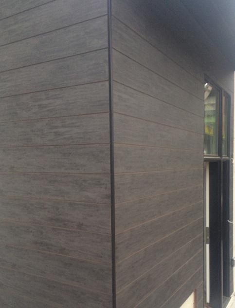 Slate Ebony Trespa Pura fush sidings with black outside corner trim.jpg