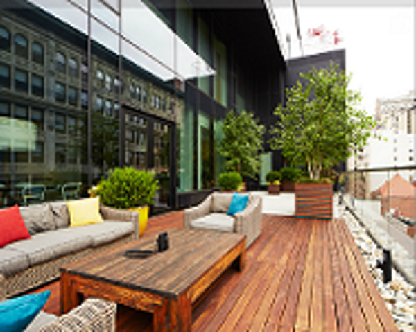 Stylish_Ipe_rooftop_deck_and_table-_Organic_Gardener.png