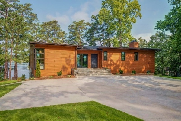 Trespa Pura Romantic Walnut cladding on lakefront home.jpg