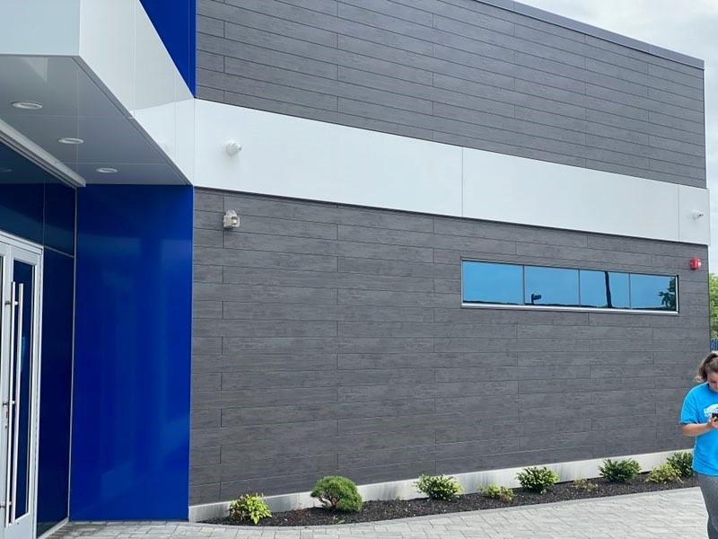 Trespa Pura Slate Ebony decor closeup of storefront front facade