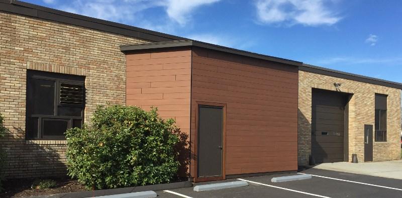 Trespa Pura Tropical Ipe wood decor siding accent on brick building
