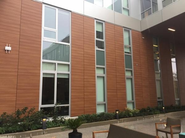 Trespa Pura clads apartment building courtyard.jpg