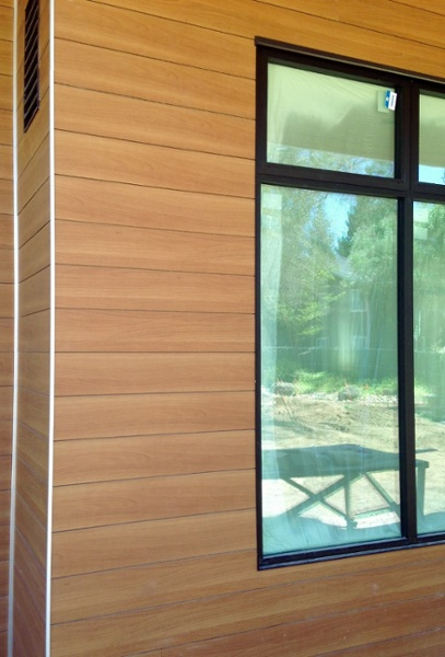 Trespa Pura flush siding - Classic Oak finish.jpg
