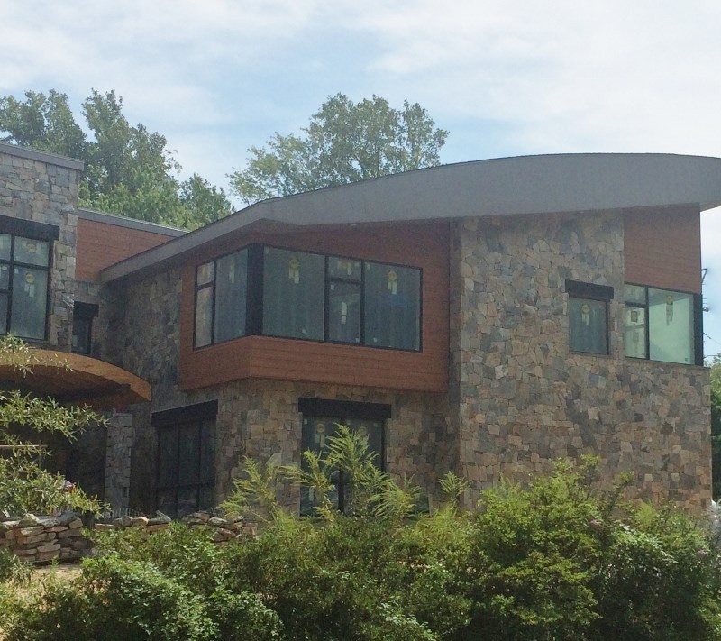Why Does Trespa Pura Siding Work Great With Natural Stone
