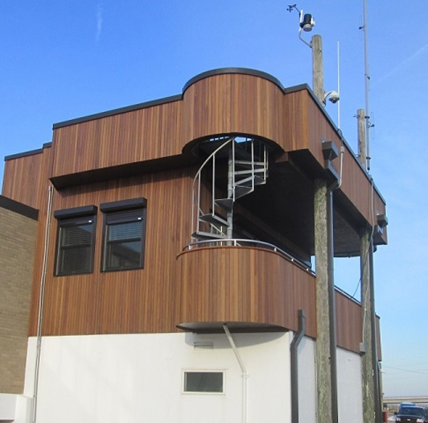 Vertical ipe rain screen siding at USCG station in Delaware